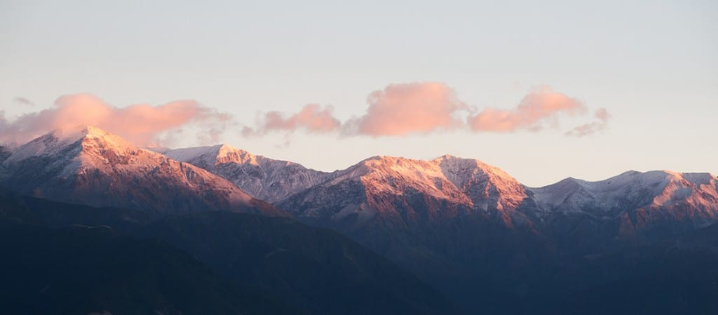 Snow-capped peaks of Kaikoura, on our new mountain bike tour new zealand south island