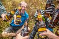 Mountain bikers have a beer break in Ecuador with H+I Adventures mountain bike vacation