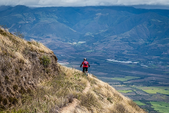 Carefully traversing mountain bike singletrack in Ecuador with H+I Adventures