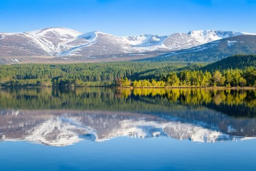 The Cairngorms on a sunny spring day. Join us on our Cairngorms mountain bike trip to experience this magnificent view in the flesh on our mountain bike tour Cairngorms