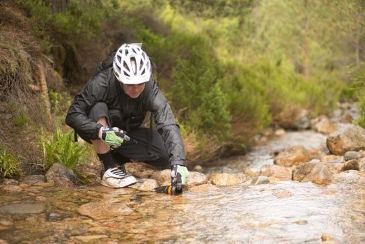 Re-filling from the streams on our mountain bike tour Cairngorms