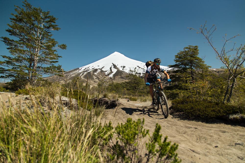 0255c4c22 Mountain biking in the shadow of Puyehue volcano in Chile on our mountain  bike tour Chile