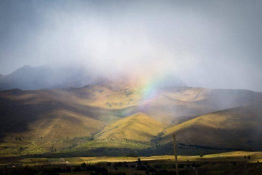 Mountain biking past rainbows and dramatic landscapes on our mountain bike tour Ecuador