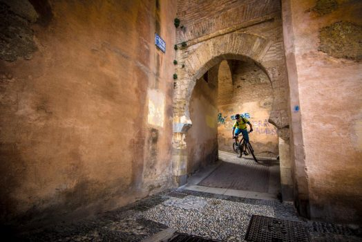 Riding the ancient streets of Granada on our mountain bike tour Spain