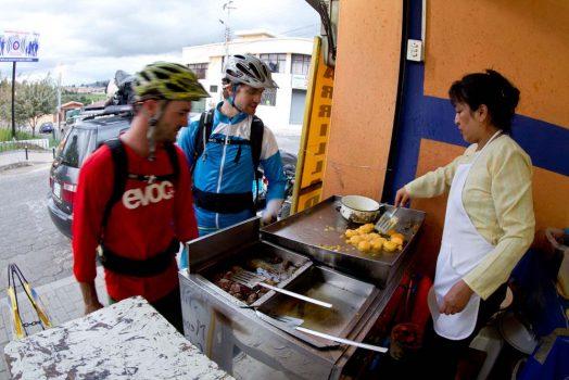 Enjoying authentic Ecuadorian street food on our mountain bike tour Ecuador