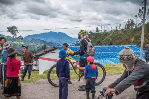Local children delight in trying our mountain bikes on H+I Adventures mountain bike tour Ecuador