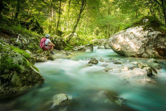 Pausing to admire the Soca River on our mountain bike tour Slovenia