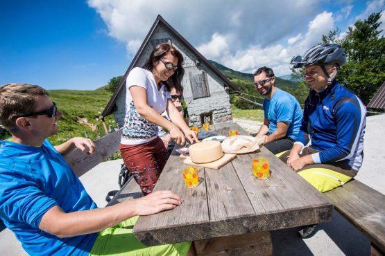 Enjoying local cheeses on our mountain bike tour Slovenia
