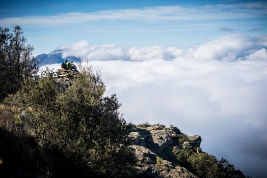 Looking out over the clouds on our mountain bike tour Spain