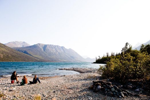 Enjoying a beer on the beach on our mountain bike tour Yukon
