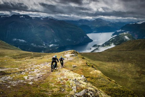 Exhilarating descent from mountain to fjord on our Fjords of Norway mountain bike tour