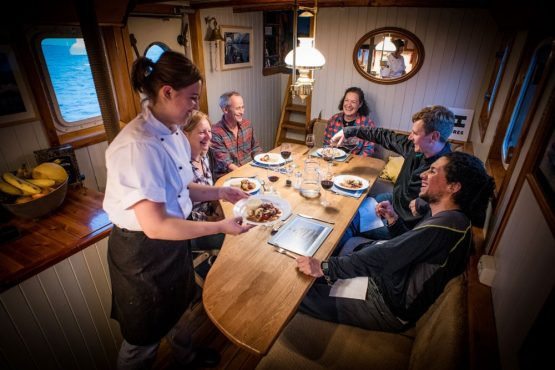 Eating and drinking aboard HMS Gåssten on our Fjords of Norway mountain bike tour