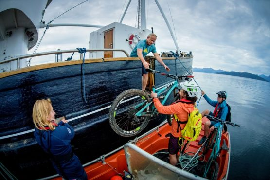 Loading bikes onto HMS Gåssten in search of more adventure in the fjords of Norway on our mountain bike tour