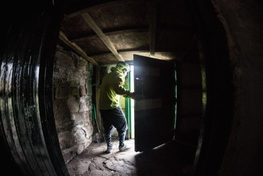 Our guide Chris heads out of a small bothy for some more great riding on our mountain bike tour Cairngorms