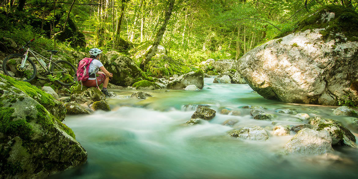 The beautiful Soča River is a gem in our mountain bike tour of Slovenia