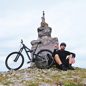 Slovenia mountain bike guide Marko taking a break at the summit