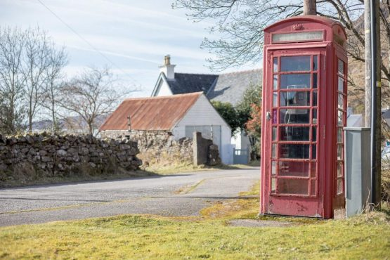 Telephone box in Torridon village, coast-to-coast Scotland mountain bike tour