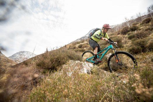Mountain biker riding rocks on our mountain bike tour Torridon and Skye.