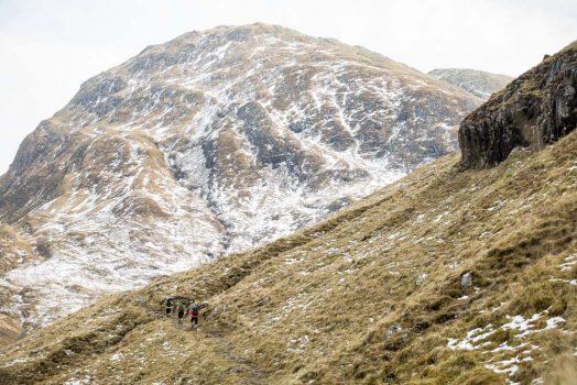 Mountain bikers carrying bikes uphill on our mountain bike tour Torridon and Skye.