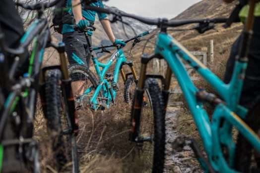 Riders resting with bikes on our mountain bike tour Torridon and Skye.