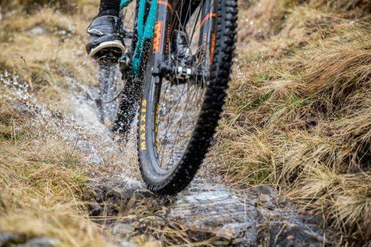 Mountainbiker riding through water on our mountain bike tour Torridon and Skye.