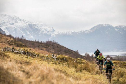Mountain bikers going uphill on our mountain bike tour Torridon and Skye.