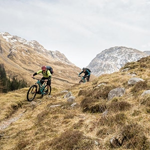 Mountain bikers descending on Torridon and Skye, part of mountain bike tours worldwide