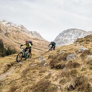 Mountain bikers descending on Torridon and Skye, part of mountain bike tours worldwide