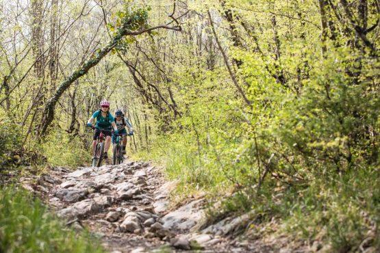 Rocky trails and bikers in Istria, mountain bike tour Croatia