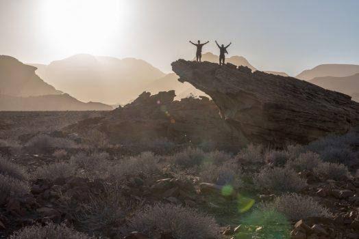 Scaling rocks on mountain bike safari tour Namibia
