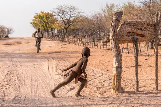 Himba villagers on mountain bike safari tour Namibia