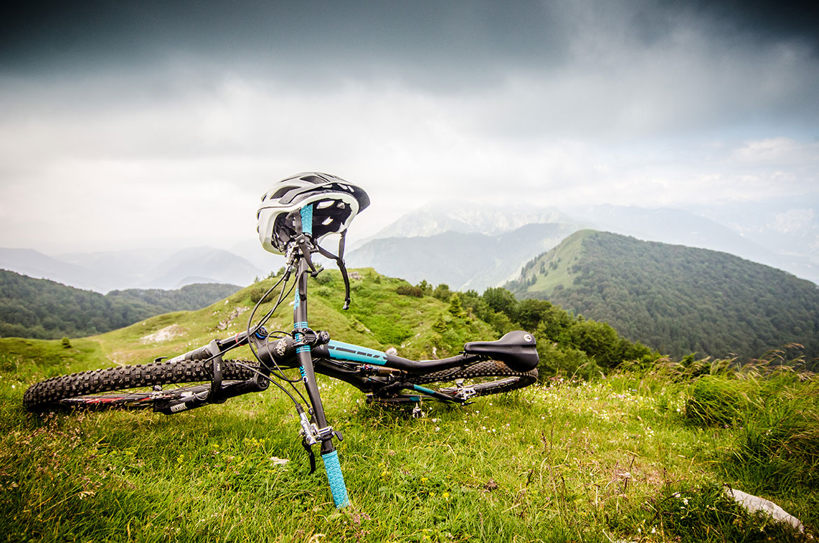Helmet resting on a bike, part of our 5 Tips For Your First Mountain Bike Tour.