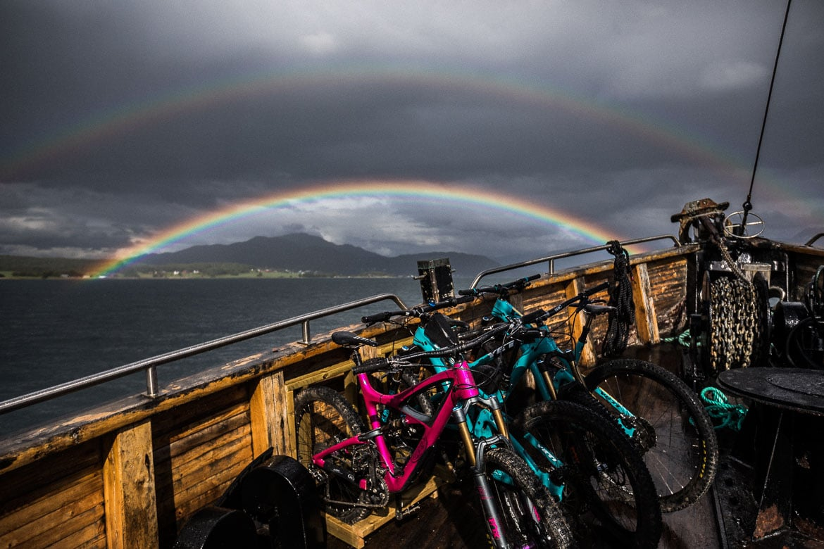 Rainbows above mountain bikes during some moody weather on our mountain bike tour Norway.