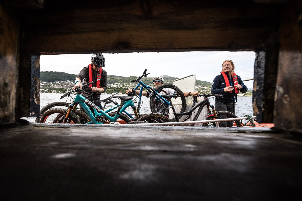 Loading bikes onto Gaasten in our Mountain bike tour Norway in photos.