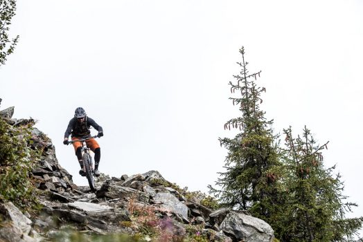 Thomas Vanderham slaying the rock gardens of the Swiss alps on our mountain bike tour Switzerland adventure