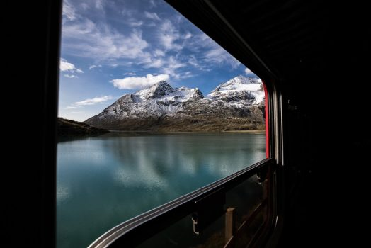 Early morning light on the Bernina Express, en-route to Italy. H+I Adventures mountain bike tour Switzerland