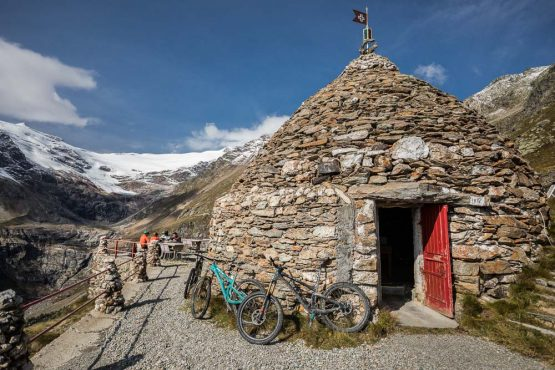 Mountain bikers taking a well earned coffee break on H+I Adventures mountain bike tour Switzerland.
