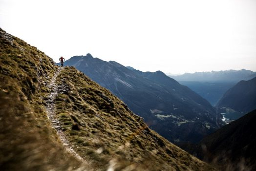 A lone mountain biker prepares to descend to two hours, mountain bike tour Switzerland delivers.