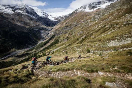 Switchbacks are a common sight in the high alpine riding on this mountain bike tour Switzerland