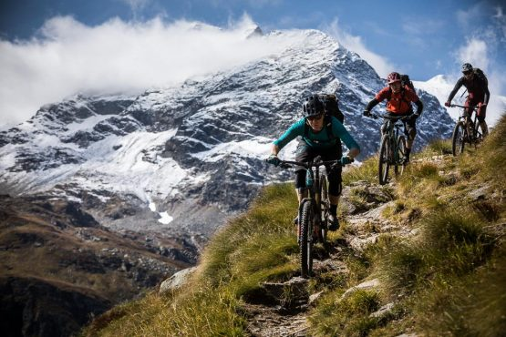 Mountain bikers descending one of the many singletrack trails on H+I Adventures mountain bike tour Switzerland