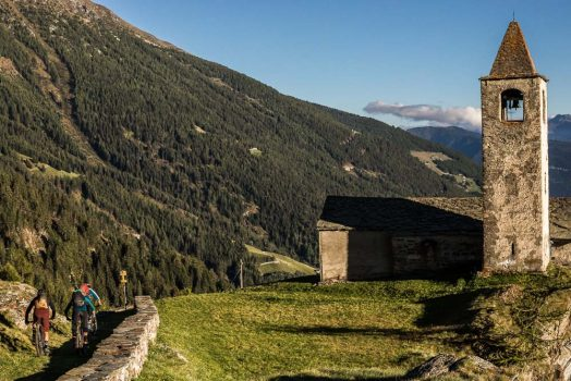 San Remerio church approaches after a hard earned descent, mountain bike tour Switzerland by H+I Adventures