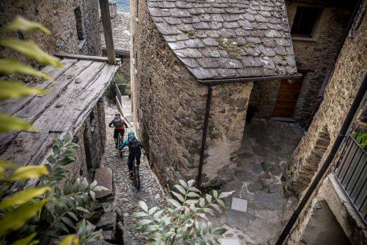 Weaving through the tight streets en-route to Tirano, Italy. Mountain bike tour Switzerland.