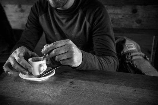 Coffee time in a warm Swiss mountain lodge, mountain bike tour Switzerland