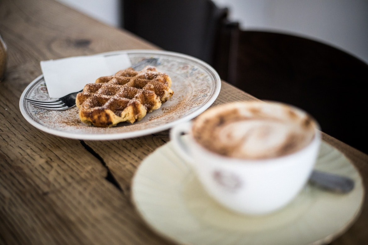 Coffee and waffle stop in Davos before riding our mountain bike tour Switzerland.