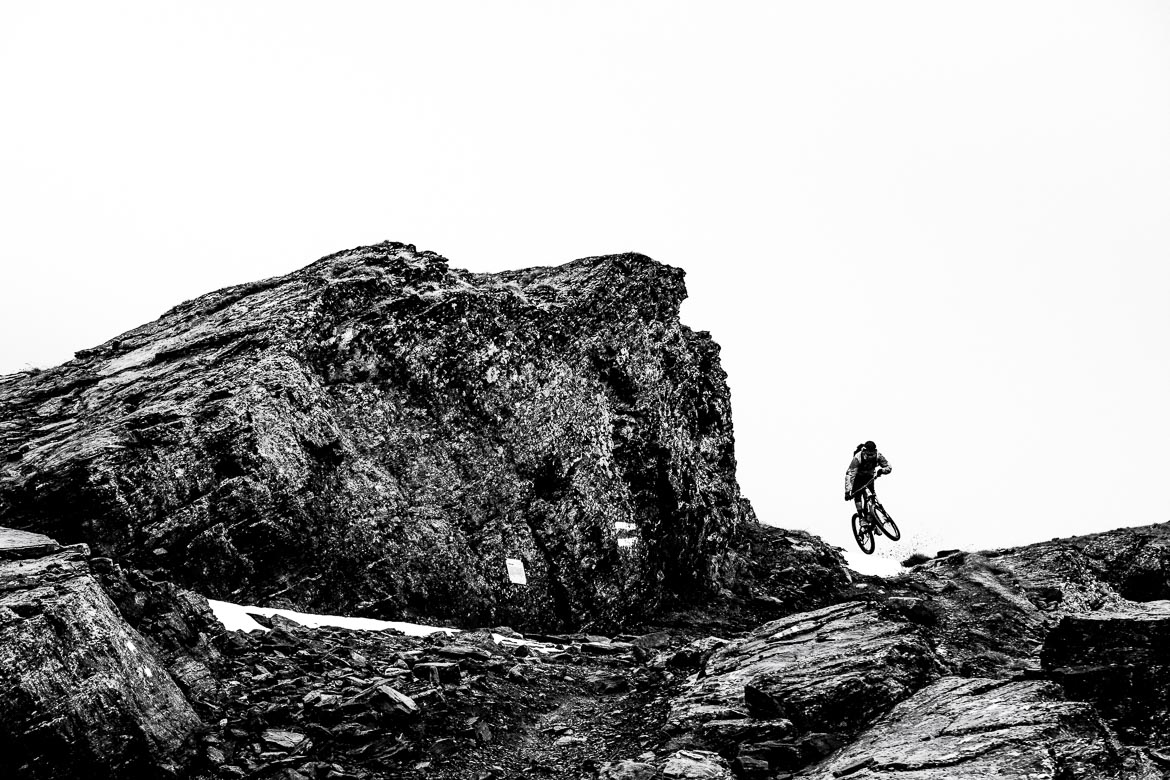 Thomas Vanderham jumping thorugh the rocky trails above Lenzerheide during our mountain bike tour of Switzerland.