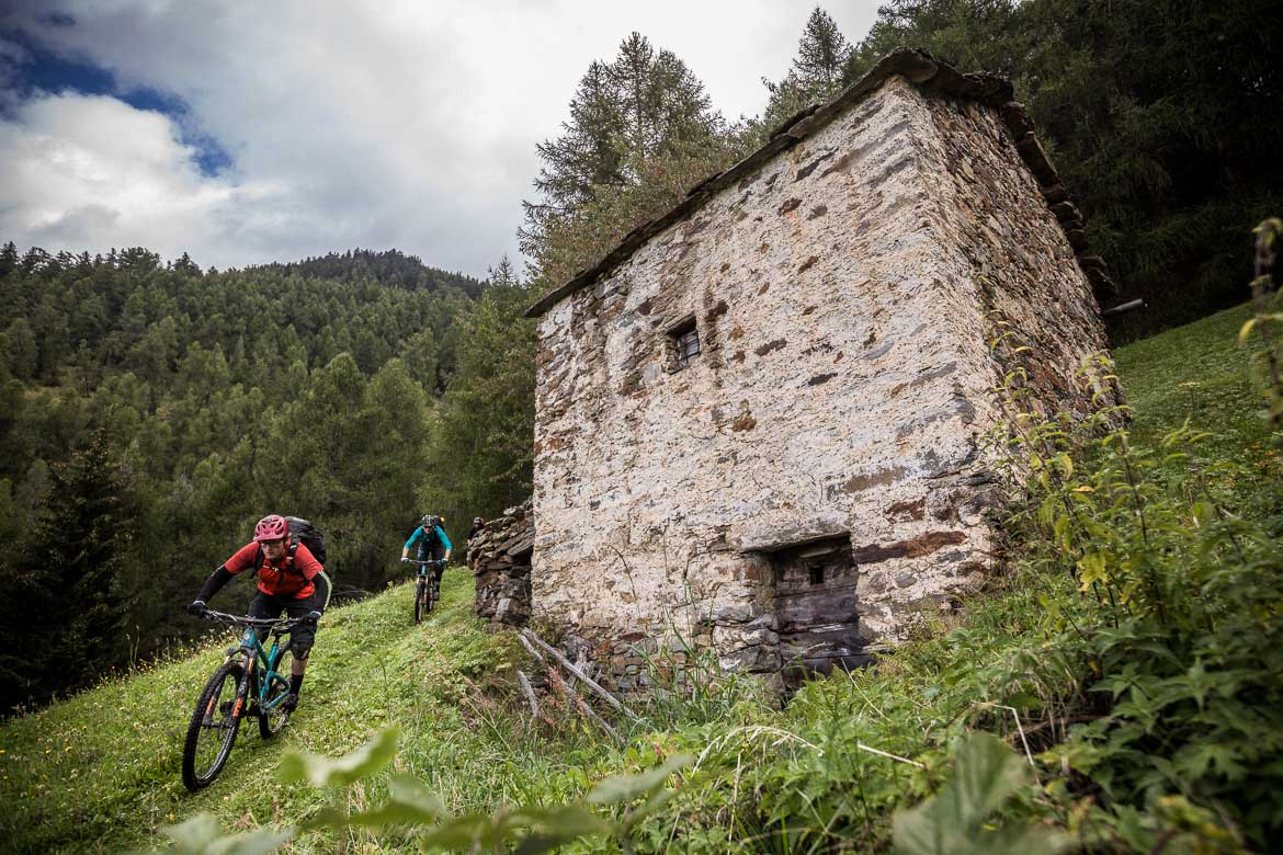 Scottish guide Mark Clark descending towards Tirano, Italy during our mountain bike tour Switzerland.