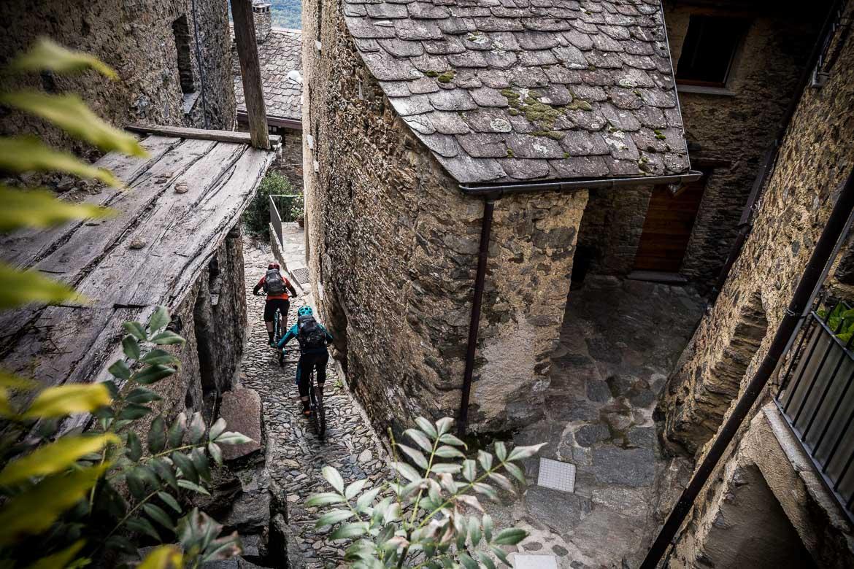 Descending through narrow alleyways towards Tirano during our mountain bike tour Switzerland.