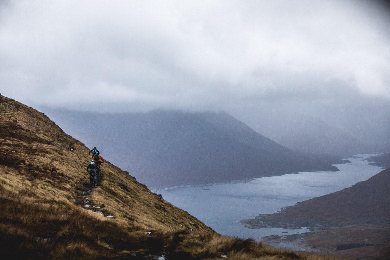 Joe Barnes, Max Schumann, and Euan Wilson riding high above Loch Quoich.