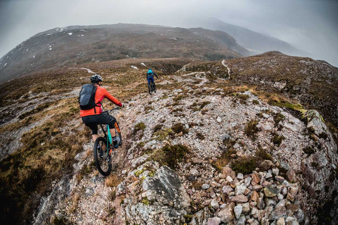 Greg Williamson leading out Scott Laughland on a descent towards Kinlochewe.