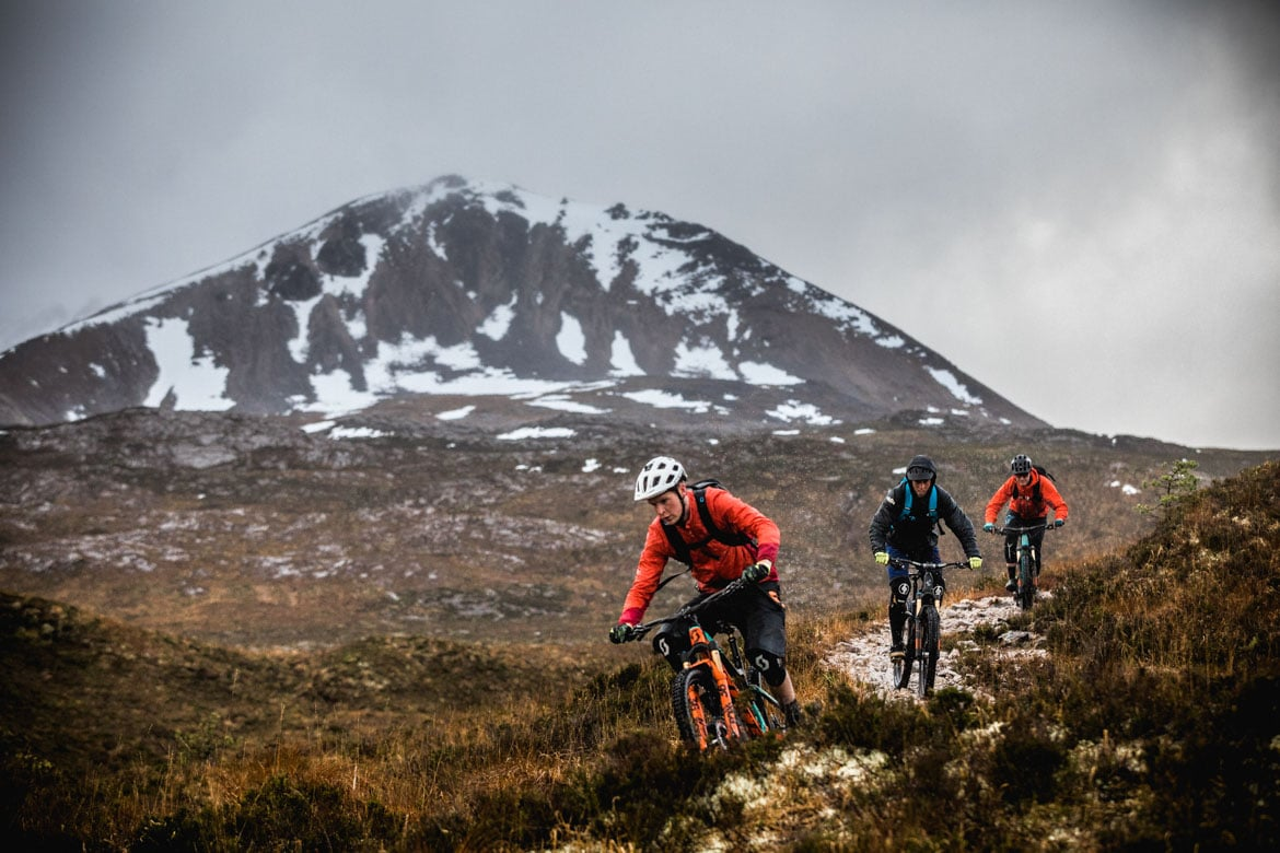 Scott Laughland leading the charge down Beinn Eighe with Greg Williamson and Euan Wilson of H+I Adventures.
